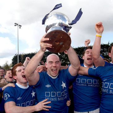 Hugh Hogan lifts the Ulster Bank League trophy