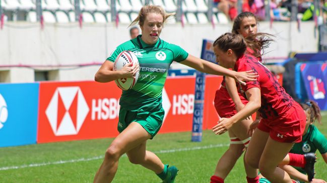 Stacey Flood is pictured on her way to the try-line