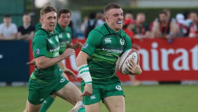 Adam Leavy breaks clear to score a try for the Ireland men