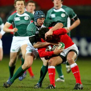 Ireland full-back Noel Reid tackles Wales' try-scoring scrum half Rhys Downes