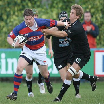 Clontarf winger Derek Keane tries to fend off Ballymena's Chris Henry