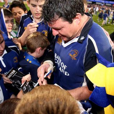 Reggie Corrigan signs autographs after his last home game for Leinster