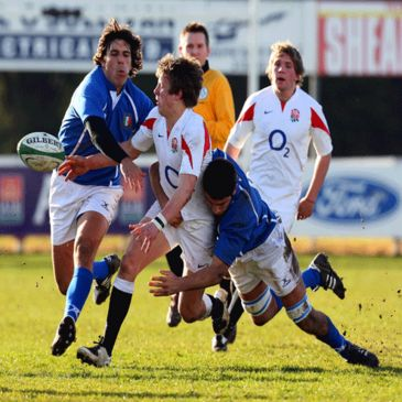 England scrum half Sam Harrison gets a pass away under pressure from the Italian defence