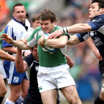 Gordon D'Arcy taking on Scotland's Rob Dewey