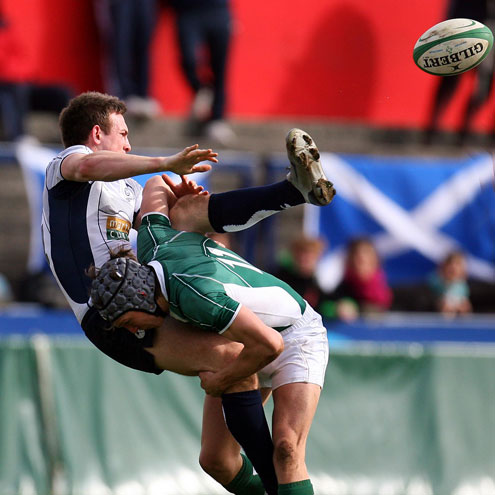 Ireland winger Michael Allen tackles Scotland's Rory Drummond