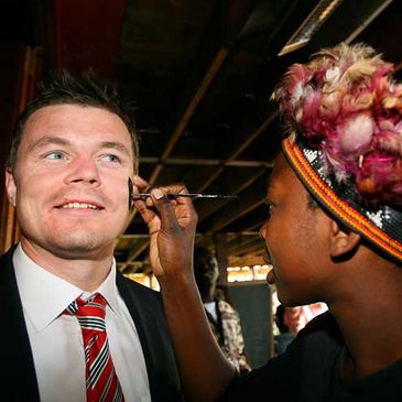 Brian O'Driscoll gets his face painted at a welcoming event
