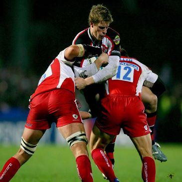 Ulster centre Andrew Trimble is tackled by Gloucester's Alex Brown and Anthony Allen