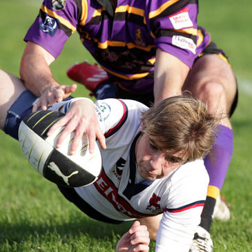 Scrum half Ian Cassidy scores a try for Old Wesley