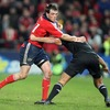 Munster winger Ian Dowling tries to fend off Hosea Gear during the Zurich Challenge match