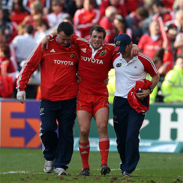 Ian Dowling is helped off at Thomond Park