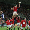 Conor Murray waits to pick up possession from a lineout as Welsh lock Ian Evans acrobatically taps the ball down