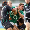Former Connacht out-half Ian Keatley is stopped in his tracks by the westerners' Ray Ofisa and Tiernan O'Halloran