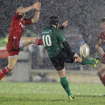 Ian Keatley tries to clear the ball under pressure from Peter Stringer