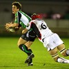 Connacht out-half Ian Keatley looks for support as he is tackled by Edinburgh's Scott Newlands