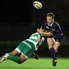 Leinster out-half Ian Madigan feels the full force of Benetton Treviso's big number 8 Manoa Vosawai