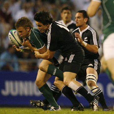 Ireland Under-20 full-back Ian Madigan is tackled by New Zealand's Zac Guildford