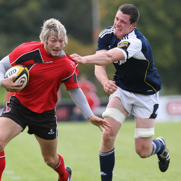 Munster lock Ian Nagle tackles Ulster Ravens' Jamie Smith