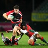 Ian Whitten, the Ulster Supporters' Bursary award winner, tries to power past Portugal's Diogo Gama and Pedro Cabral