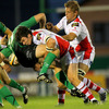 Ulster centre Ian Whitten puts in a big tackle on Connacht's Gavin Duffy as the sides battle it out