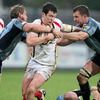 Ulster's young centre Ian Whitten tries to fend off the attentions of Jamie Robinson and Deiniol Jones