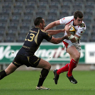 Ulster centre Ian Whitten tries to get past Sonny Parker of the Ospreys