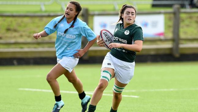 Railway Union's Aimee Clarke runs in a try for the Combined Provinces side