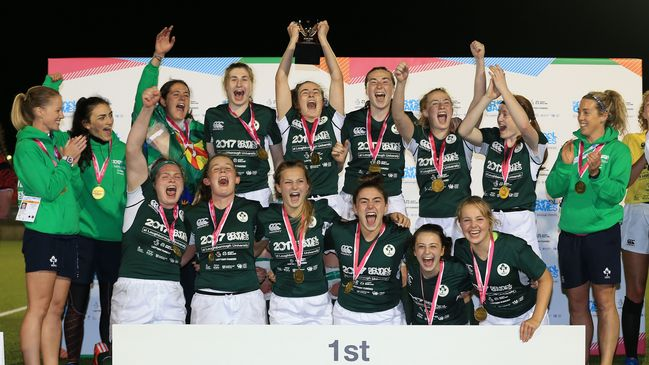 Emily Lane lifts the trophy as Ireland celebrate their School Games title win