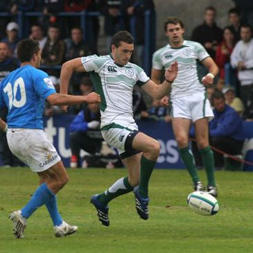 Ireland winger David Kearney tries to hack the ball on