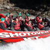 Donncha O'Callaghan, Donnacha Ryan and captain Brian O'Driscoll pose for the cameras as the jet boat makes it way through the spectacular Shotover River canyons
