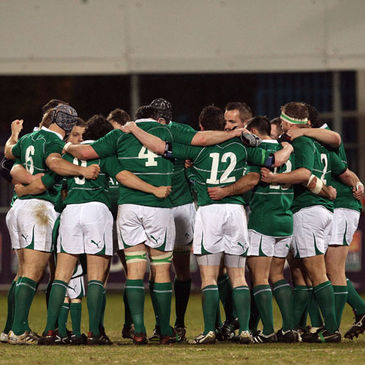 The Ireland Club XV players huddle together