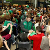 Gordon D'Arcy and Jamie Heaslip are pictured signing autographs for the Ireland fans as the players emerge at the arrivals hall