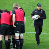 Ireland defence coach Les Kiss makes his way across the pitch as the players get together in a huddle