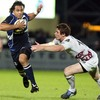 Isa Nacewa tries to slip through a gap in the Ospreys midfield, with Andrew Bishop in close company