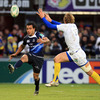 Leinster full-back Isa Nacewa goes the aerial route as Clermont Auvergne captain Aurelien Rougerie attempts a block