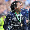 Leinster full-back Isa Nacewa, proudly displaying his winner's medal, is doused in Heineken