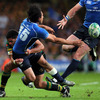 Leinster full-back Isa Nacewa gets his offload away under pressure from Northampton replacement Joe Ansbro