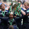 Devin Toner and Leo Cullen place the Heineken Cup trophy on the head of a delighted Isa Nacewa