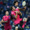 Leinster go the aerial route once again and winger Isa Nacewa is pictured beating Cardiff skipper Xavier Rush to a high ball