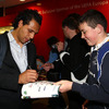 Leinster full-back Isa Nacewa, who is in contention for the ERC Player of the Year award, signs an autograph for a young supporter