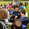 Isa Nacewa and Dominic Ryan sign autographs as giant lock Devin Toner poses for a photograph in the background
