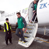 Isaac Boss is pictured making his way down the steps of the plane following its arrival at New Plymouth Airport earlier today