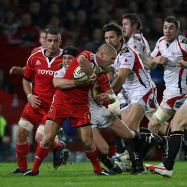 Munster's Paul Warwick is tackled by Ulster scrum half Isaac Boss