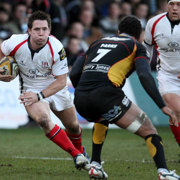 Ulster scrum half Isaac Boss takes on the Dragons' Richard Parks