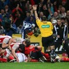 Scrum half Isaac Boss is supported by his team-mates as referee Alain Rolland signals for Ulster's third try
