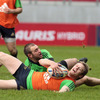 Ivan Dineen gets the better of fellow back Johne Murphy as the players train in wet conditions in Limerick