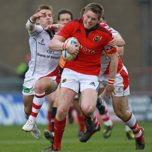 Ulster scrum half Paul Marshall tackles Munster's Ivan Dineen