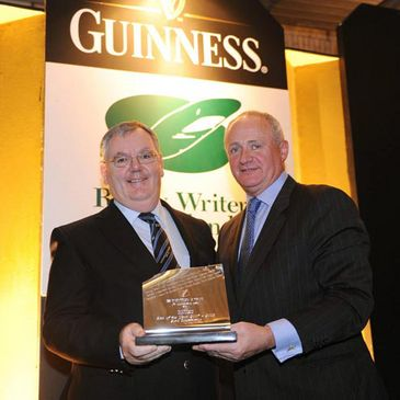 Jack O'Sullivan is presented with Cork Constitution's award