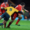 Munster number 8 James Coughlan leads by example as he tries to shrug off Luke Burgess' challenge