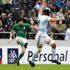 Ireland out-half James McKinney kicks for touch, nudging the ball away from the grasp of Argentinian lock Lucas Ponce