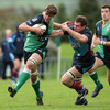 Ballynahinch number 8 James Simpson attempts to fend off Belfast Harlequins' Neil McComb during Saturday's Division 1B encounter at Ballymacarn Park